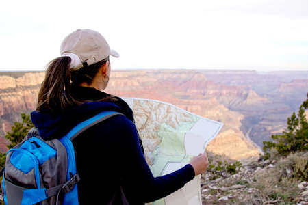 Adventurous female at the Grand Canyon holding a map  photo