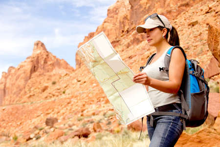 Woman exploring at the Grand Canyon with a map  photo