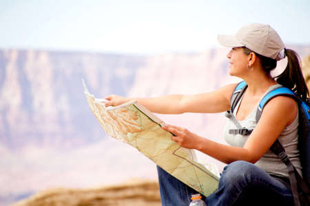 Female tourist holding a map at the desert  photo