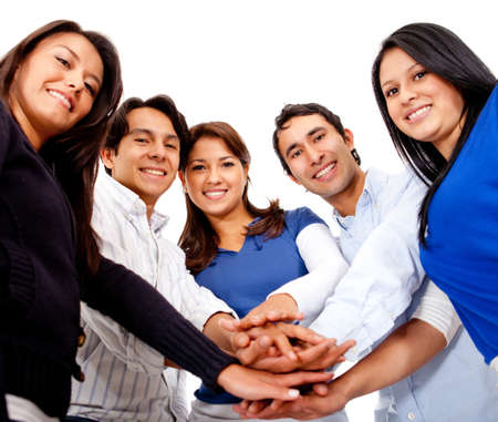 close together: Group of people with hands together in the middle - isolated