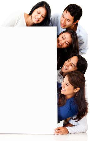 Group of people looking at a poster - isolated over a white background  photo