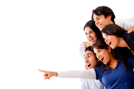woman pointing: Woman pointing and a surprised group looking - isolated Stock Photo