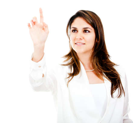 finger touch: Businesswoman touching and imaginary screen with her finger - isolated