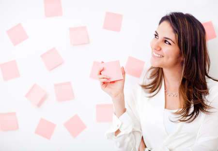 multitask: Multitask business woman with post-its and smiling