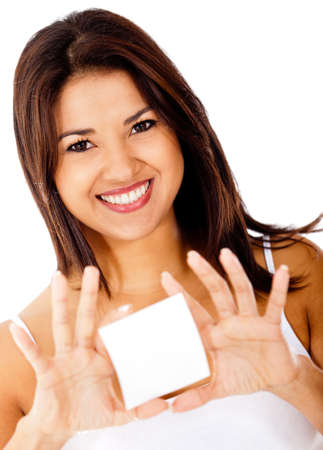 Woman holding a white card and smiling � isolated  photo