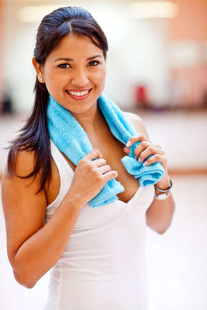 Sporty woman at the gym holding a towel  Stock Photo - 13439688