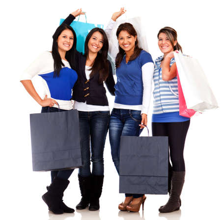 Group of shopping women with bags - isolated over white  photo