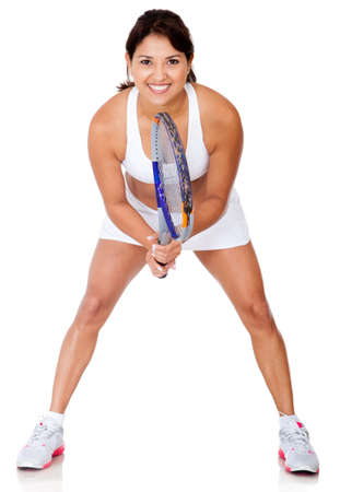 Female tennis player holding racket - isolated over white  photo