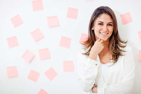 multitask: Multitask businesswoman with post-its and smiling