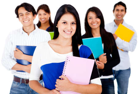 Happy female student with a group - isolated over a white background  photo