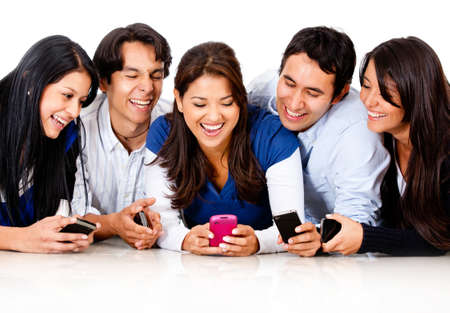 telephones: Happy group of friends gossiping on a cell phone  Stock Photo