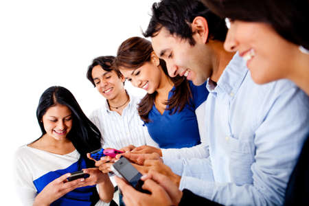 mobile telephones: Group of young people texting on their phones - isolated over white