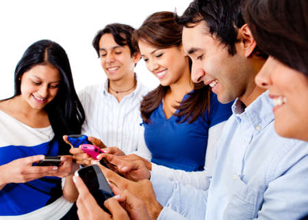 telephones: Group of friends text messaging on their phones  Stock Photo