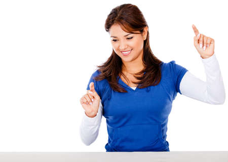 Woman pointing with two fingers - isolated over a white background   photo
