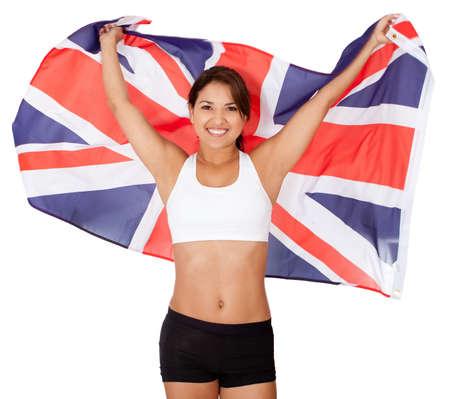 bandera de reino unido: Deportista femenina con la bandera de Reino Unido - aislados en un blanco backrground Foto de archivo