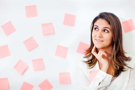 eventful: Pensive business woman thinking about her tasks  Stock Photo
