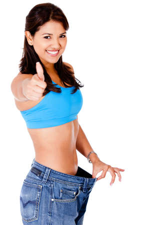 baggy: Woman in baggy pants with thumbs up - isolated over a white background