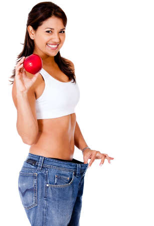over eating: Healthy eating woman in loose pants - isolated over a white background  Stock Photo