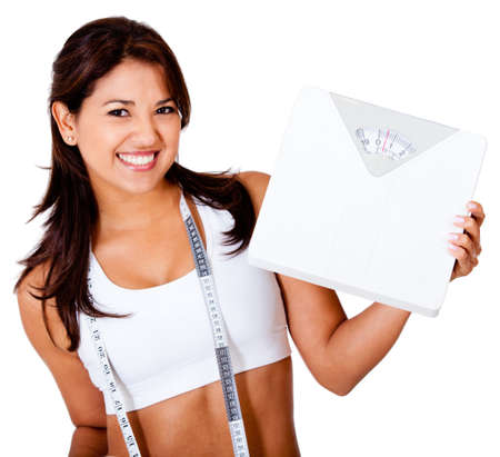 loss: Thin woman loosing weight and holding a scale - isolated over white