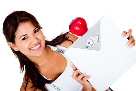 Woman on a diet to loose weight holding a scale - isolated over white  photo