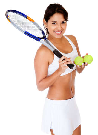 Female tennis player holding racket and balls - isolated  photo