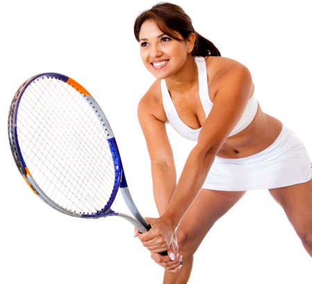 Woman playing tennis - isolated over a white background  photo