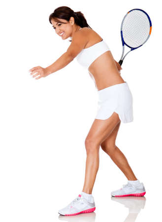 Sportive woman playing tennis - isolated over a white background  photo