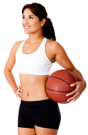 Woman holding a basketball - isolated over a white background  photo