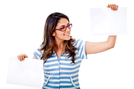 Woman holding two pieces of paper - isolated over white  photo