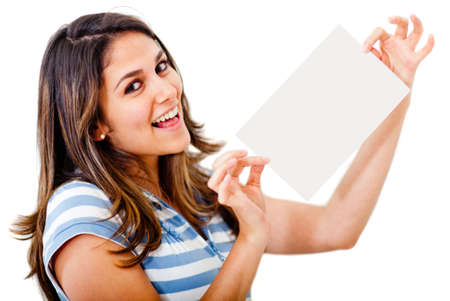 Beautiful woman holding a paper and smiling - isolated over a white background  photo