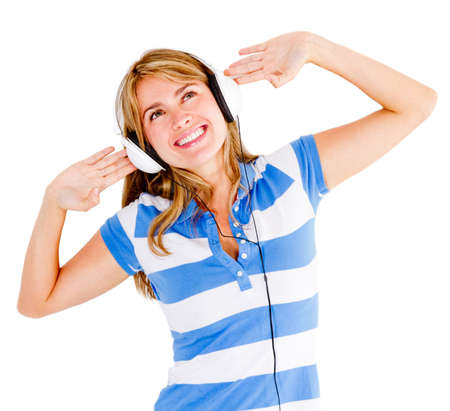 Woman excited about music wearing headphones - isolated over white Stock Photo - 13440167
