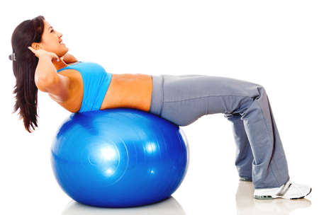swiss ball: Athletic woman exercising with a Swiss ball - isolated over white  Stock Photo