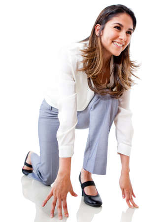 Businesswoman in position to run - isolated over a white background  photo