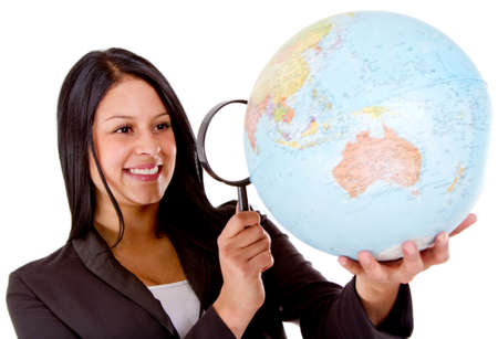 Woman looking for her next tavel destination with a magnifying glass - isolated  photo