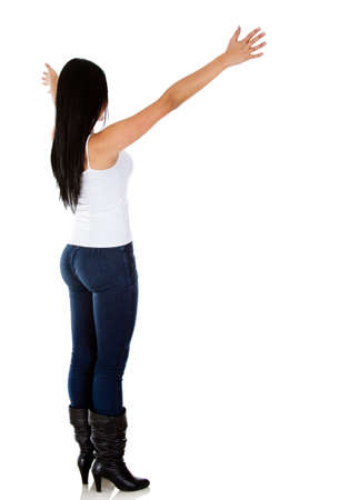 Rear view of a woman with arms open - isolated over white  photo
