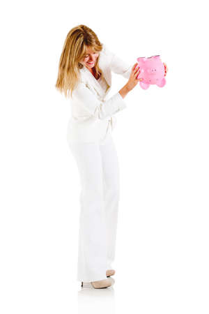 Woman emptying a piggybank - isolated over a white background Stock Photo - 13535582