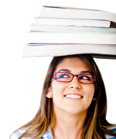 geeky: Geeky female student with books on her head - isolated over white
