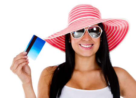Woman planning her vacations and holding card - isolated over a white background  photo