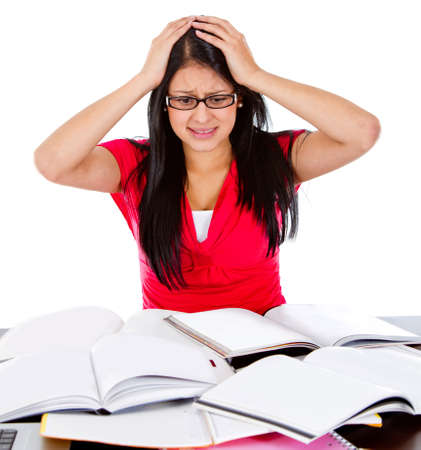preoccupied: Frustrated female student with books - isolated over a white background