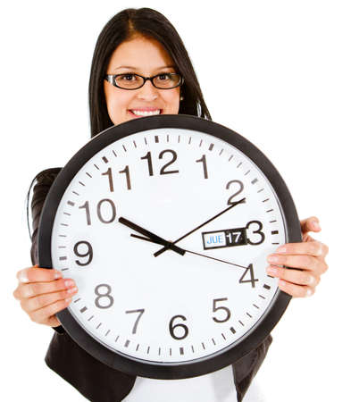Business time with a woman holding a clock - isolated over white  Stock Photo - 13535713