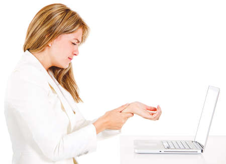 carpal tunnel: Businesswoman with a laptop suffering from carpal tunnel syndrome - isolated over a white background