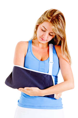 Woman with a broken arm - isolated over a white background  photo