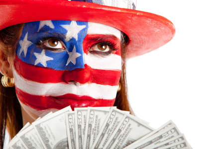 Rich American woman with the USA flag painted on her face holding dollars