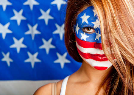 Patriotic American woman with the USA flag painted on her face   photo