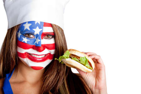 American woman eating a hamburger � fast food concepts   photo