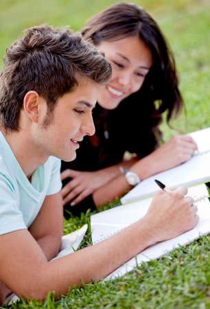 college campus: Couple of students lying outdoors and smiling