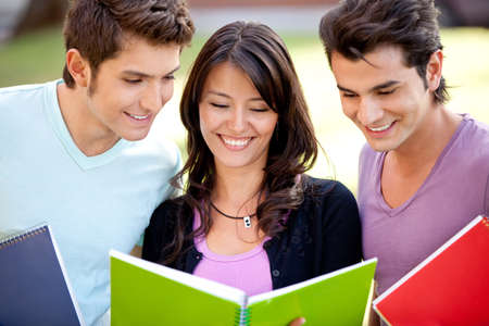 Group of students with notebooks smiling outdoors  photo