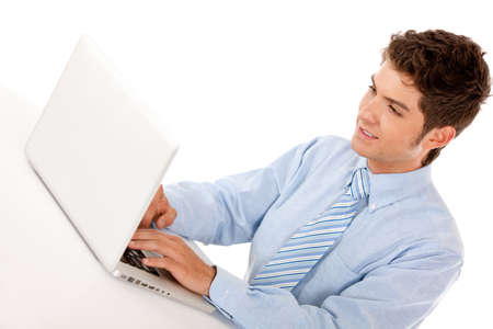 Business man working on a laptop computer � isolated  photo