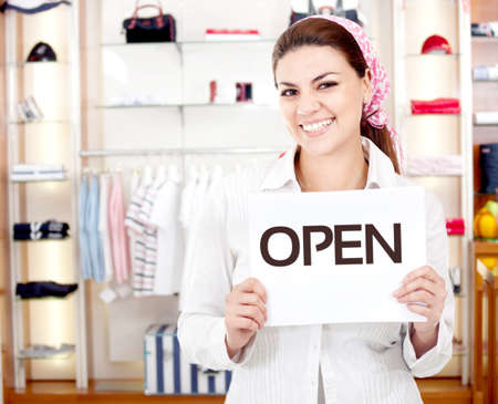 Female business owner opening a new retail store photo