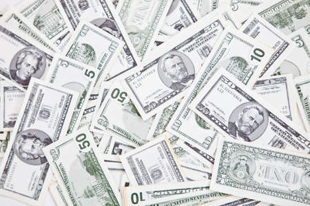 capitalismo: Closeup to a bunch of dollar bills - money concepts